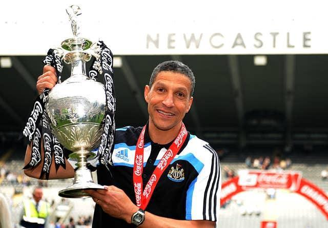 Newcastle manager Chris Hughton celebrates with the Championship trophy