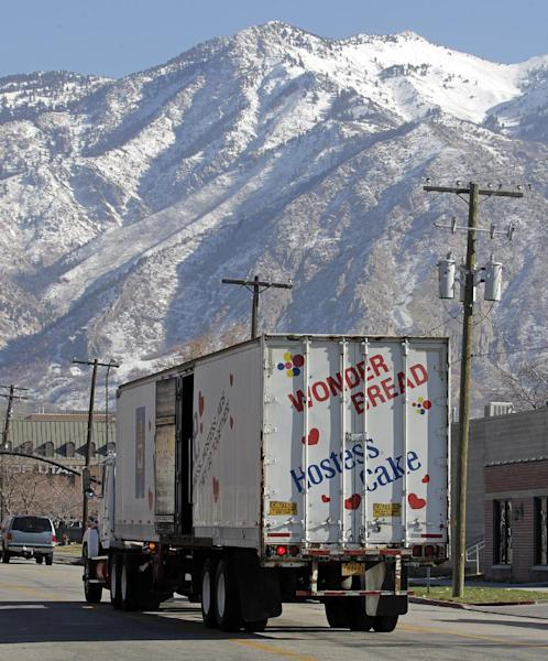 A Hostess Wonder Bread truck is parked in front of the Utah Hostess plant in Ogden, Utah, Thursday, Nov. 15, 2012. Hostess Brands Inc. is warning striking employees that it will move to liquidate the company if plant operations don't return to normal levels by Thursday evening. The maker of Twinkies, Ding Dongs and Wonder Bread said Thursday it will file a motion in U.S. Bankruptcy Court to shutter operations if enough workers don't return by 5 p.m. EST. That would result in the loss of about 18,000 jobs, including hundreds in Ogden. (AP Photo/Rick Bowmer)