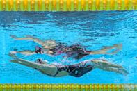 <p>An underwater view shows USA's Regan Smith competing in the final of the women's 100m backstroke swimming event during the Tokyo 2020 Olympic Games at the Tokyo Aquatics Centre in Tokyo on July 27, 2021. (Photo by François-Xavier MARIT / AFP)</p>