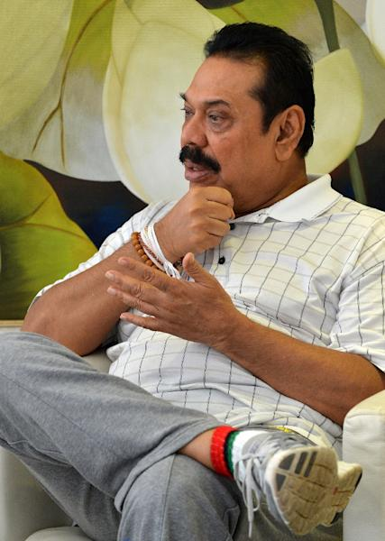 Former Sri Lankan president Mahinda Rajapakse speaks to an AFP journalist during an interview in Colombo, on April 22, 2015 (AFP Photo/Ishara S. Kodikara)