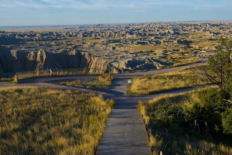 <p>The walking trail loops down to a scenic overlook at the Badlands National Park, South Dakota // October 18, 2015</p>