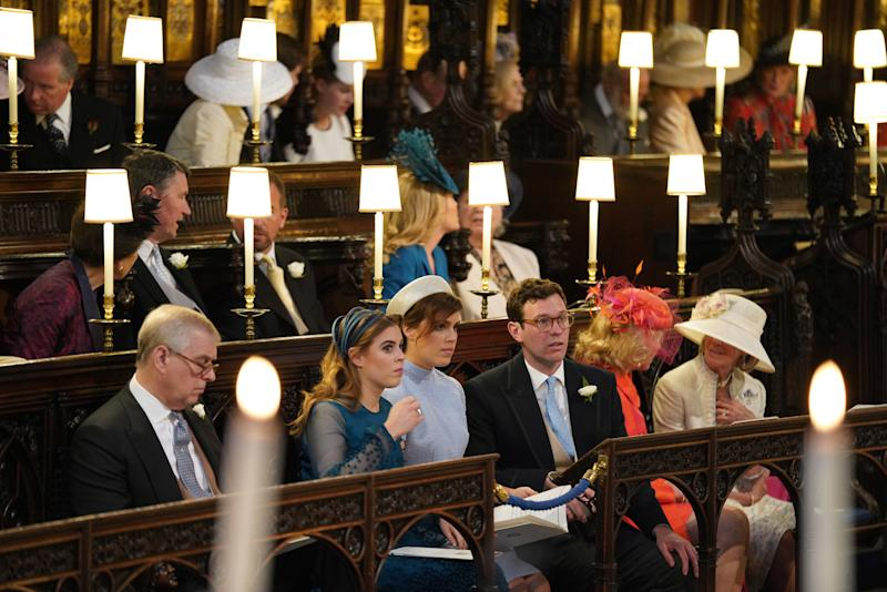 Prince Andrew, Duke of York, Princess Beatrice, Princess Eugenie and Jack Brooksbank sit in St George's Chapel at Windsor Castle ahead of the wedding of Prince Harry and Meghan Markle on May 19, 2018 in Windsor, England.