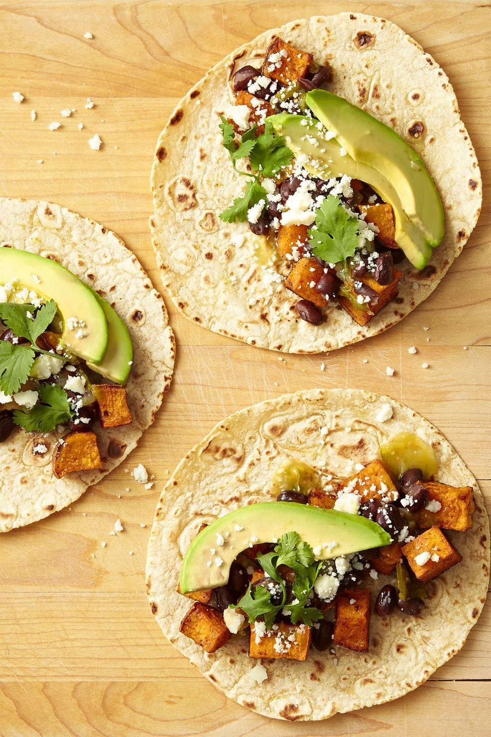 """<p>Spicy sweet potatoes and black beans make the ultimate vegetarian taco filling. We promise — you won't miss the beef.</p><p><em><a href=""""https://www.goodhousekeeping.com/food-recipes/easy/a44227/sweet-potato-avocado-black-bean-tacos-recipe/"""" rel=""""nofollow noopener"""" target=""""_blank"""" data-ylk=""""slk:Get the recipe for Sweet Potato, Avocado and Black Bean Tacos »"""" class=""""link rapid-noclick-resp"""">Get the recipe for Sweet Potato, Avocado and Black Bean Tacos »</a></em></p>"""