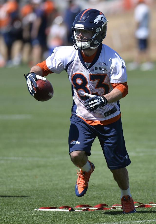 Denver Broncos' Wes Welker runs a drill during an NFL football organized team activity, Monday, June 2, 2014, in Englewood, Colo. (AP Photo/Jack Dempsey)