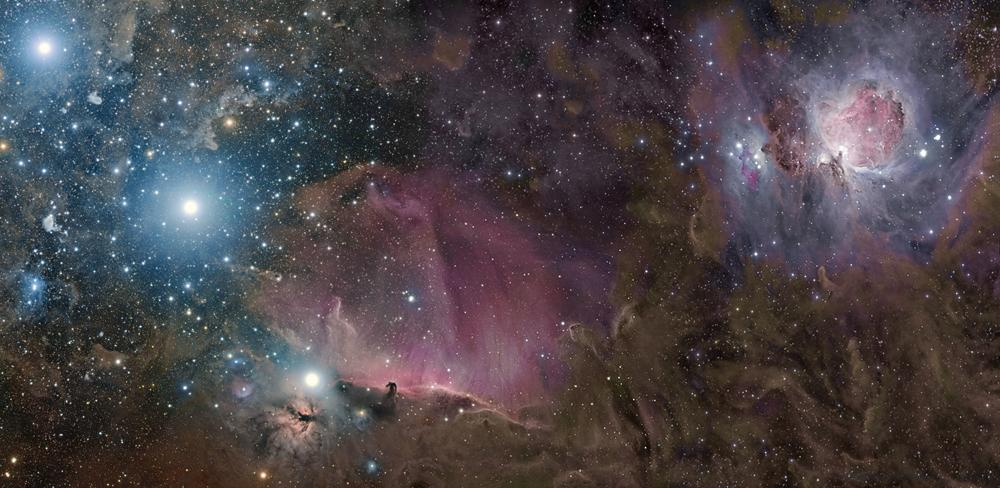 The three bright stars on the left in this image are the stars of Orion's Belt.  Although part of a familiar constellation, a view such as this can never be seen with the naked eye. Only with long exposure time and a sensitive camera can we see the dramatic landscape of glowing gas and dust clouds that lie between the visible stars. This vast region of space includes the famous Orion and Horsehead Nebulae. Rogelio Bernal Andreo was the Winner of the 'Deep Space' category, Astronomy Photographer of the Year, 2010 (Orion Deep Wide Field © Rogelio Bernal Andreo, 2009)