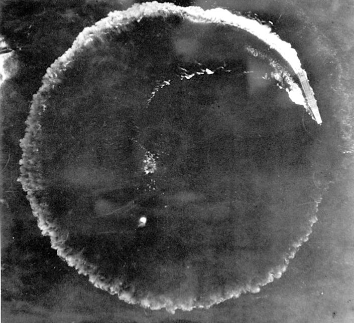 FILE - This June 1942 file photo shows an aerial photo of a Japanese carrier maneuvering in a complete circle in an effort to escape in the Midway Islands, Hawaii. After the battle, the Army reported repeated bomb hits on the enemy carriers Kaga and Akagi, while the Navy, in listing results, said four enemy carriers were definitely sunk. A research vessel called the Petrel is launching underwater robots about halfway between the U.S. and Japan in search of warships from the Battle of Midway. (AP Photo/U.S. Army, File)