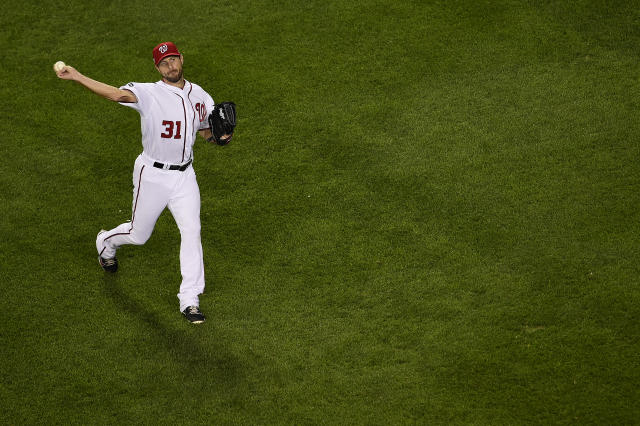 Max Scherzer warms up before his start in the National League wild-card game against the Milwaukee Brewers on Tuesday. (Photo by Patrick McDermott/Getty Images)
