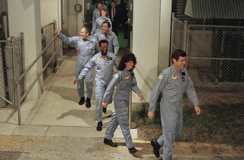 "FILE - In this Jan. 27, 1986, file photo, the crew for the Space Shuttle Challenger flight 51-L leaves their quarters for the launch pad at the Kennedy Space Center in Florida. Mission Spl. Ronald McNair, center, was only the second African American chosen to go to space. He died in the Challenger launch. The documentary ""Black in Space: Breaking the Color Barrier"" is scheduled to air on the Smithsonian Channel on Monday, Feb. 24, 2020, and examines the race to get black astronauts into space. (AP Photo/Steve Helber, File)"