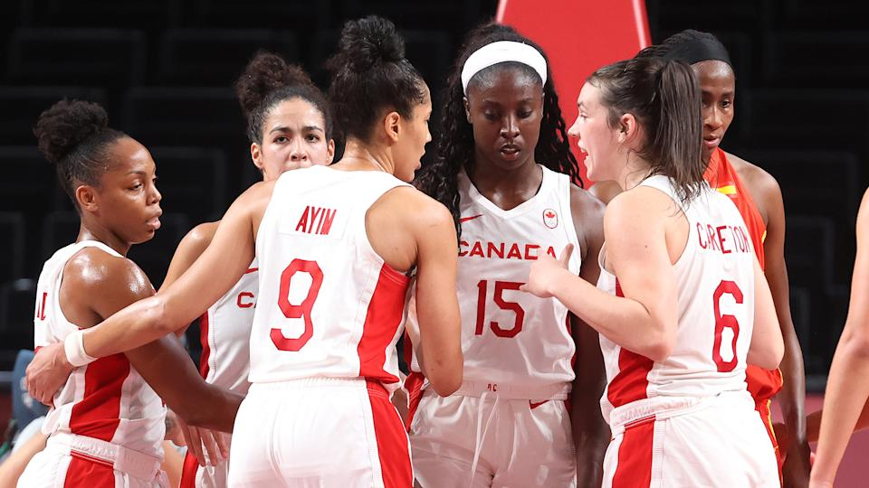 Members of Team Canada huddle during the second half of a Women's Basketball Preliminary Round Group A game against Spain at Saitama Super Arena on August 01, 2021 in Saitama, Japan. (Photo by Gregory Shamus/Getty Images)