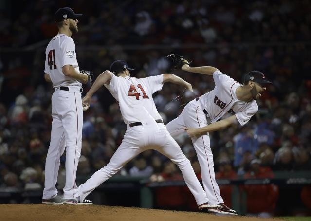 This multiple exposure shows Boston Red Sox starting pitcher Chris Sale throwing during the fourth inning of Game 1 of the World Series baseball game against the Los Angeles Dodgers Tuesday, Oct. 23, 2018, in Boston. (AP Photo/Matt Slocum)