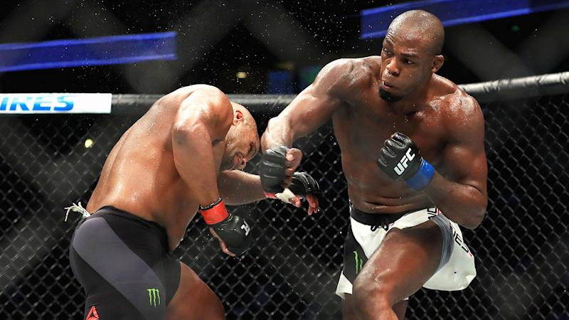 Jon Jones is seen here hitting Daniel Cormier during their fight at UFC 214.