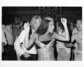 <p>Cher and her boyfriend, Gregg Allman of the Allman Brothers, attend a party for the Doobie Brothers in Los Angeles in 1975. Cher and Allman began dating after her separation from Sonny Bono and got married just days after her divorce was finalized. </p>
