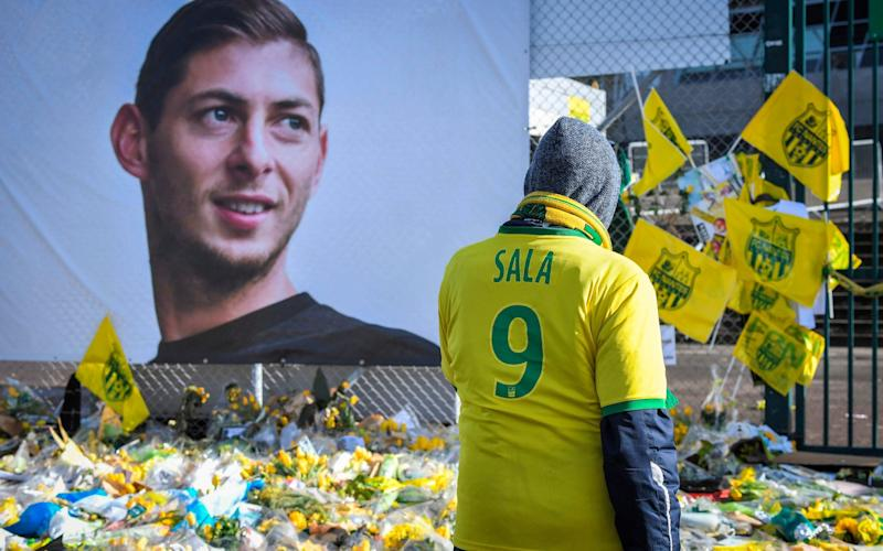 Nantes fans pay tribute to their former striker, Emiliano Sala - AFP