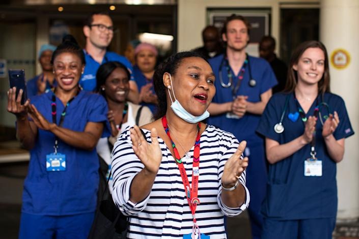 It's been just over a year since Clap for Carers started in the UK. Here NHS staff at Chelsea and Westminster Hospital participate in the clap in May 2020. (Getty Images)