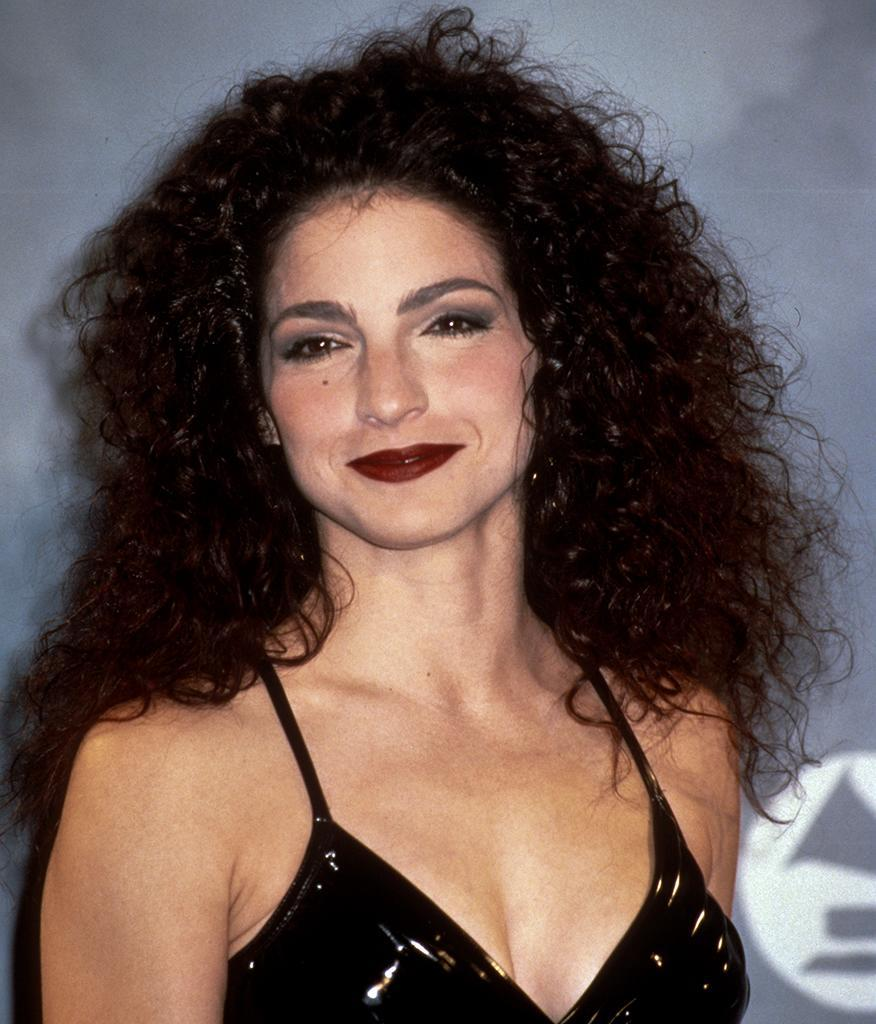 "<p>If the rhythm wasn't going to get you, <a href=""https://www.yahoo.com/lifestyle/tagged/gloria-estefan"" data-ylk=""slk:Gloria Estefan"" class=""link rapid-noclick-resp"">Gloria Estefan</a>'s signature spirals were. While her teased tresses (and bright makeup) were all the rage in the early '90s, the Cuban hitmaker later shifted to smoother strands and lighter makeup, both of which we associate with the star all these years later. Curled or not, ensure a <a href=""https://www.yahoo.com/lifestyle/tagged/frizz"" data-ylk=""slk:frizz"" class=""link rapid-noclick-resp"">frizz</a>-free look with humidity-fighting <a href=""https://www.yahoo.com/lifestyle/newest-curly-hair-offerings-seriously-151702821.html"" data-ylk=""slk:styling products;outcm:mb_qualified_link;_E:mb_qualified_link;ct:story;"" class=""link rapid-noclick-resp yahoo-link"">styling products</a>. (Photo: Getty Images) </p>"