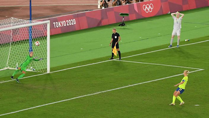 Sweden's Caroline Seger launches a penalty kick over the crossbar.