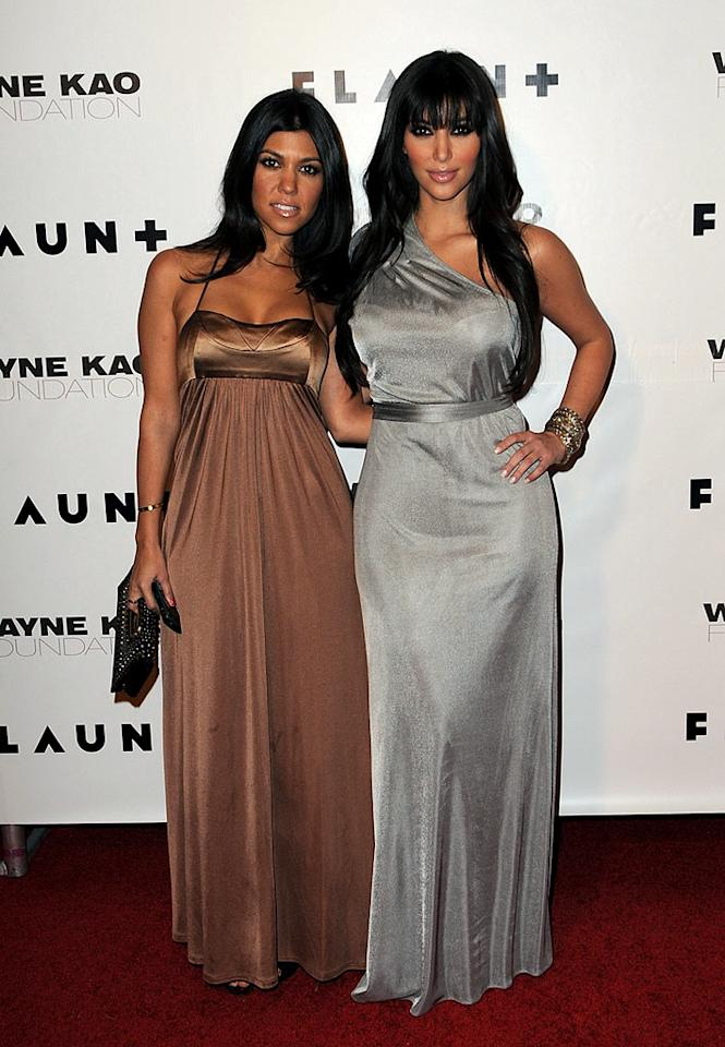 "Sisters Kourtney and Kim Kardashian both rocked metallic frocks. Whose dress do you prefer? Jordan Strauss/<a href=""http://www.wireimage.com"" target=""new"">WireImage.com</a> - December 18, 2008"