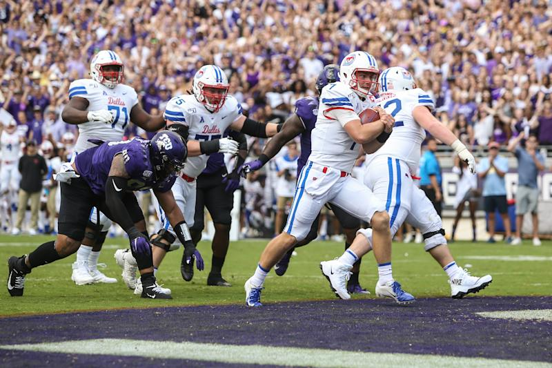 FORT WORTH, TX - SEPTEMBER 21: Southern Methodist Mustangs quarterback Shane Buechele (7) runs into the end zone for a touchdown during the game between SMU and TCU on September 21, 2019 at Amon G. Carter Stadium in Fort Worth, TX. (Photo by George Walker/Icon Sportswire via Getty Images)