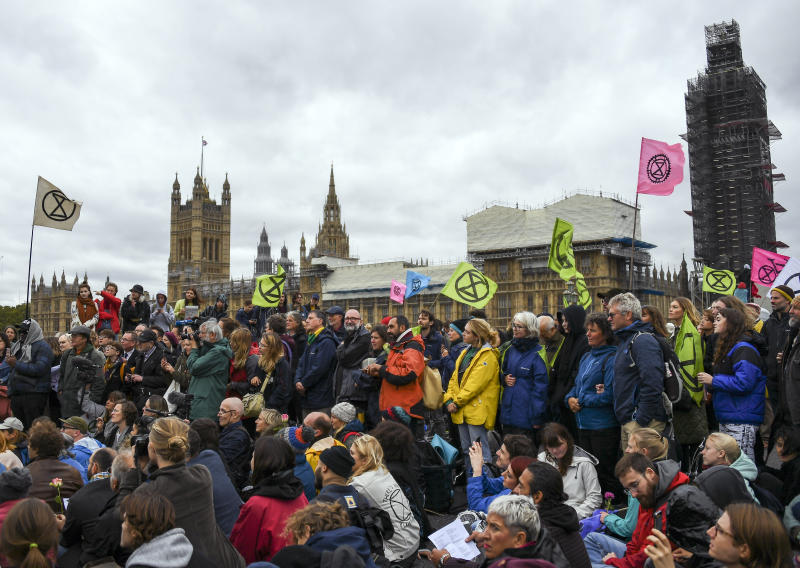 Climate activist gather on Westminster Bridge, during an Extinction Rebellion protest in London, Monday, Oct. 7, 2019. London Police say some 135 climate activists have been arrested as the Extinction Rebellion group attempts to draw attention to global warming. Demonstrators playing steel drums marched through central London on Monday as they kicked off two weeks of activities designed to disrupt the city. (AP Photo/Alberto Pezzali)