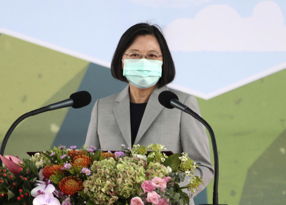 """Taiwanese President Tsai Ing-wen delivers a speech as she inaugurates an F-16 maintenance center at the Aerospace Industrial Development Corp. (AIDC) in Taichung, central Taiwan, Friday, Aug. 28, 2020. Amid rising threats from China, Tsai on Friday said the self-governing island was determined to strengthen its defenses. Tsai said Taiwan wanted to """"let the world to see our strong will in protecting the country.""""  (AP Photo/Chiang Ying-ying)"""