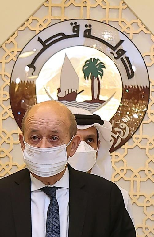French Foreign Minister Jean-Yves Le Drian, seen on a September 2021 visit to Qatar, has no meeting scheduled with US Secretary of State Antony Blinken amid anger over a submarine deal (AFP/KARIM JAAFAR)