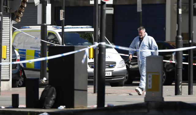 <p>A forensic officer leaves the scene where a van struck pedestrians in Finsbury Park, north London, Monday, June 19, 2017. (Photo: Alastair Grant/AP) </p>