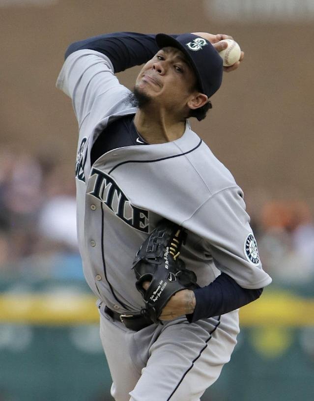 Seattle Mariners' Felix Hernandez pitches against the Detroit Tigers during the first inning of a baseball game Saturday, Aug. 16, 2014, in Detroit. (AP Photo/Duane Burleson)