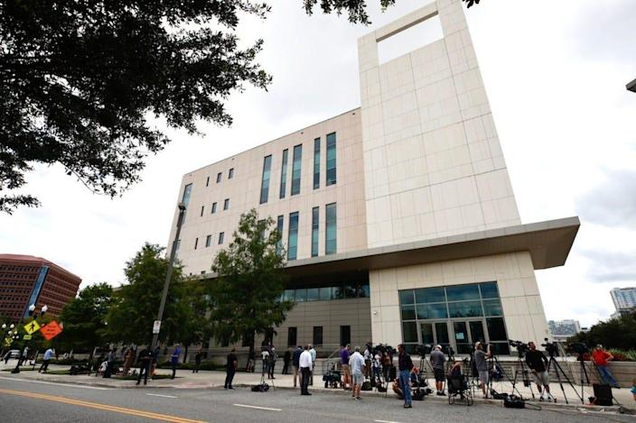 Members of the media stake out the federal courthouse in Orlando on Monday, May 17, 2021. Former Seminole County tax collector Joel Greenberg pleaded guilty to six of 33 charges he's been indicted.