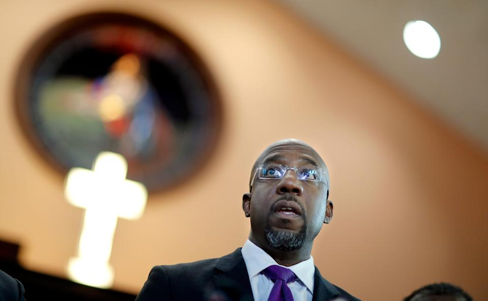 """Rev. Raphael Warnock, responds to President Donald Trump's comments about Haiti and Africa while speaking at Ebenezer Baptist Church where Rev. Martin Luther King Jr. preached in Atlanta, Friday, Jan. 12, 2018. Warnock and other faith leaders condemned Trump's """"vile and racist"""" remarks made on the eve of the Martin Luther King Jr. holiday weekend. Warnock said it's hypocritical for Trump to sign a proclamation honoring King, given his comments. """"A giant of a man does not need a proclamation from a small man like Donald Trump,"""" Warnock said. (AP Photo/David Goldman) ORG XMIT: GADG108"""