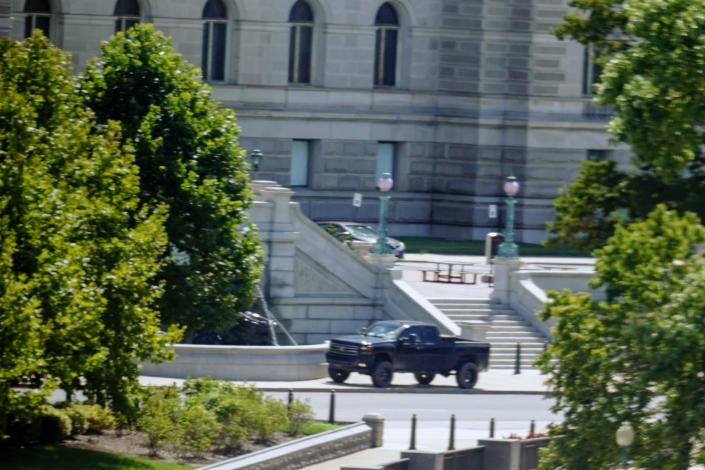 A pickup truck is parked on the sidewalk in front of the Library of Congress's Thomas Jefferson Building on Thursday.