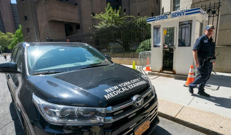 A New York Medical Examiner's car is parked outside the Metropolitan Correctional Center in New York, where well-connected accused sex trafficker Jeffrey Epstein was found dead while in detention (AFP Photo/Don Emmert)