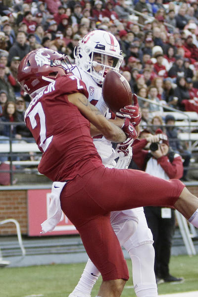 Washington State cornerback Derrick Langford, left, disrupts a pass intended for Stanford wide receiver Brycen Tremayne during the second half of an NCAA college football game in Pullman, Wash., Saturday, Nov. 16, 2019. Washington State won 49-22. (AP Photo/Young Kwak)