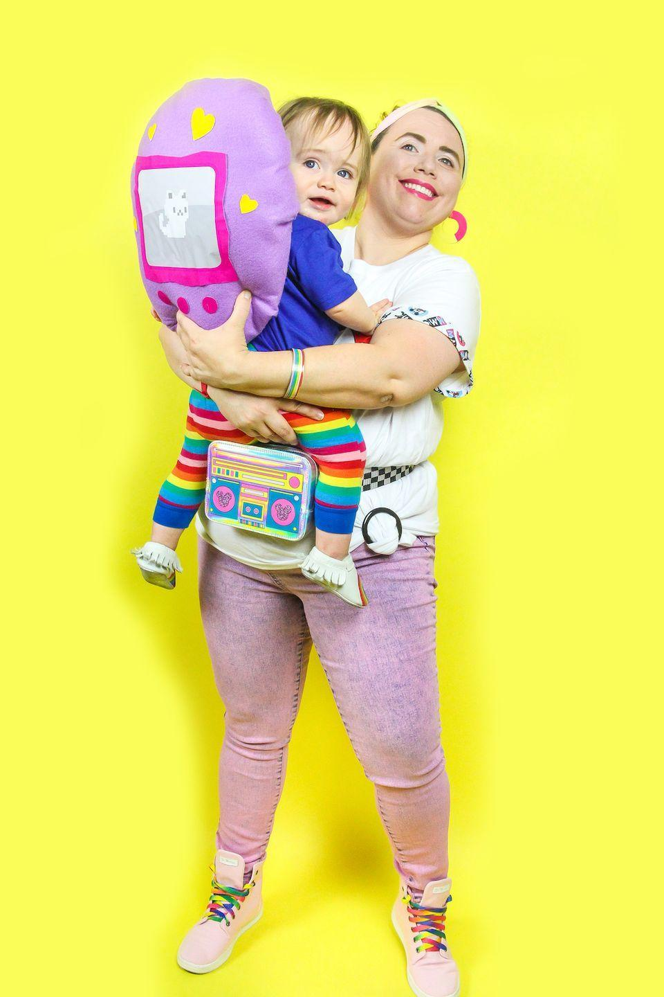 """<p>Here's a fun costume for a duo—parent and child or two best friends—a '90s teen and their trusty Tamagotchi. </p><p><em><a href=""""https://briteandbubbly.com/90s-throwback-teen-and-tomagotchi-themed-mommy-me-costume/"""" rel=""""nofollow noopener"""" target=""""_blank"""" data-ylk=""""slk:Get the tutorial."""" class=""""link rapid-noclick-resp"""">Get the tutorial.</a></em></p><p><a class=""""link rapid-noclick-resp"""" href=""""https://www.amazon.com/MIAIULIA-Waist-Costumes-Festival-Travel/dp/B07K78552L?tag=syn-yahoo-20&ascsubtag=%5Bartid%7C10072.g.37059504%5Bsrc%7Cyahoo-us"""" rel=""""nofollow noopener"""" target=""""_blank"""" data-ylk=""""slk:SHOP FANNY PACK"""">SHOP FANNY PACK</a></p>"""