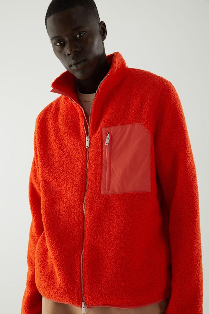 Photo of a model wearing a COS jacket.
