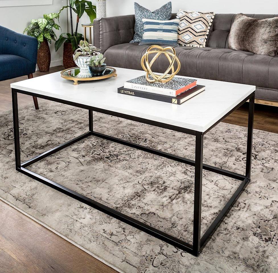 """<p>This <a href=""""https://www.popsugar.com/buy/Walker%20Edison%20White-Faux%20Marble%20Coffee%20Table-472499?p_name=Walker%20Edison%20White-Faux%20Marble%20Coffee%20Table&retailer=macys.com&price=135&evar1=casa%3Aus&evar9=46422177&evar98=https%3A%2F%2Fwww.popsugar.com%2Fhome%2Fphoto-gallery%2F46422177%2Fimage%2F46422183%2FWalker-Edison-White-Faux-Marble-Coffee-Table&list1=shopping%2Cfurniture%2Cmacys%2Chome%20shopping&prop13=mobile&pdata=1"""" rel=""""nofollow"""" data-shoppable-link=""""1"""" target=""""_blank"""" class=""""ga-track"""" data-ga-category=""""Related"""" data-ga-label=""""https://www.macys.com/shop/product/42-white-faux-marble-mixed-material-coffee-table-with-black-base?ID=6786986&amp;tdp=cm_app~zMCOM-NAVAPP~xcm_zone~zPDP_ZONE_A~xcm_choiceId~zcidM05MDU-605cf9fa-3d36-420a-9366-34ba5b9627d4%40H7%40customers%2Balso%2Bshopped%2429391%246786986~xcm_pos~zPos1~xcm_srcCatID~z22672"""" data-ga-action=""""In-Line Links"""">Walker Edison White-Faux Marble Coffee Table</a> ($135, originally $300) looks triple the price.</p>"""