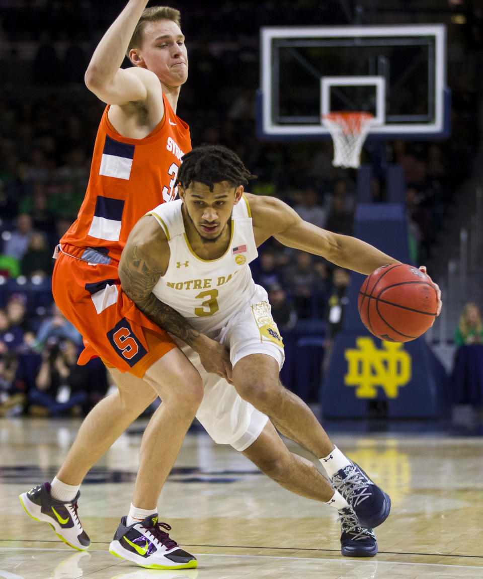 Notre Dame's Prentiss Hubb (3) drives by Syracuse's Buddy Boeheim(35) during the first half of an NCAA college basketball game Wednesday, Jan. 22, 2020, in South Bend, Ind. (AP Photo/Robert Franklin)