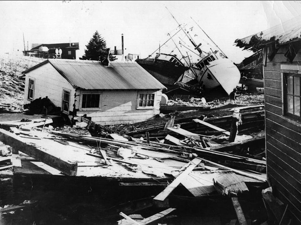 A small fishing village on Kodiak Island in Alaska littered with debris from houses and boats after an earthquake and tidal wave struck it on 4 April 1964 (Central Press/Getty)