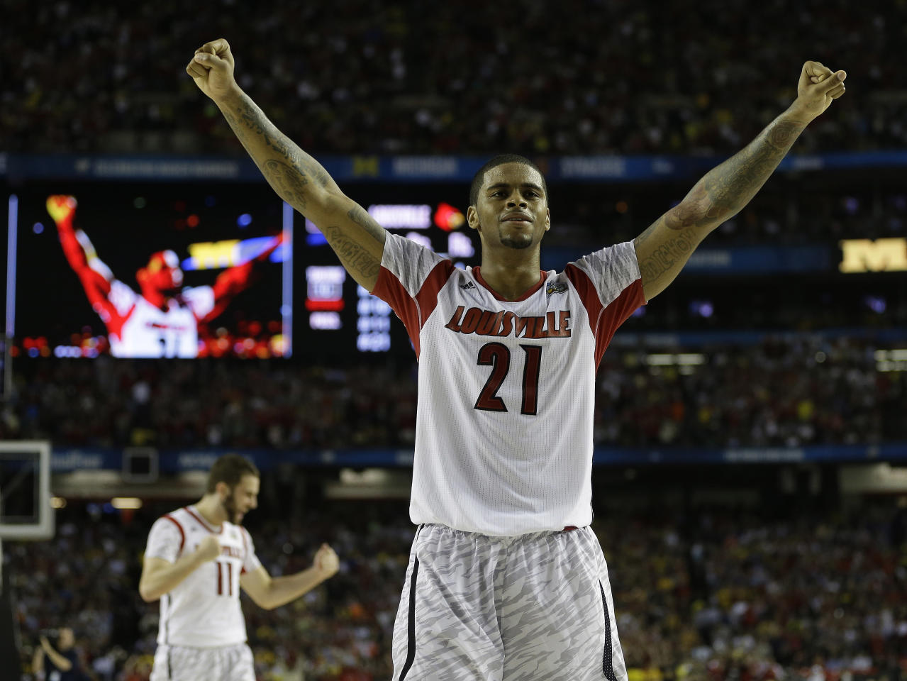 Louisville forward Chane Behanan (21) reacts after defeating Michigan 82-76 in the NCAA Final Four tournament college basketball championship game, Monday, April 8, 2013, in Atlanta. (AP Photo/David J. Phillip)