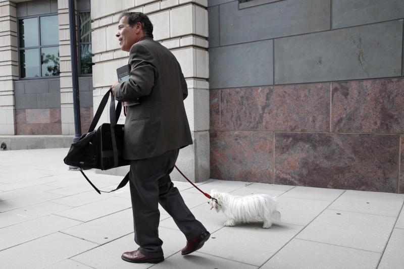 New York radio host Randy Credico, with his dog Bianca, walks away from federal court after appearing before Mueller's grand jury Friday, Sept. 7, 2018, in Washington. (Photo: Jacquelyn Martin/AP)