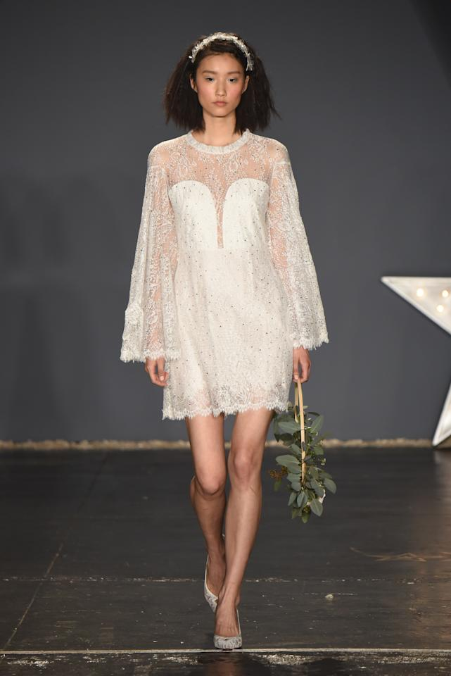<p>This dress is made for a bohemian-style ceremony, with it's beautiful bell sleeves and embellished details. Add a headpiece, and this look is sure to be a wedding day classic.</p>
