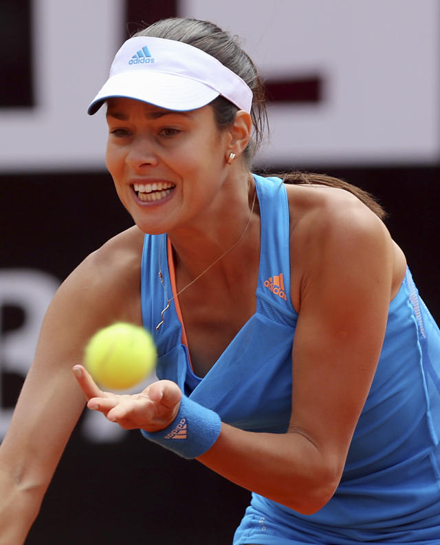 Serbia's Ana Ivanovic returns the ball to Russia's Maria Sharapova during their match at the Italian open tennis tournament in Rome, Thursday, May 15, 2014