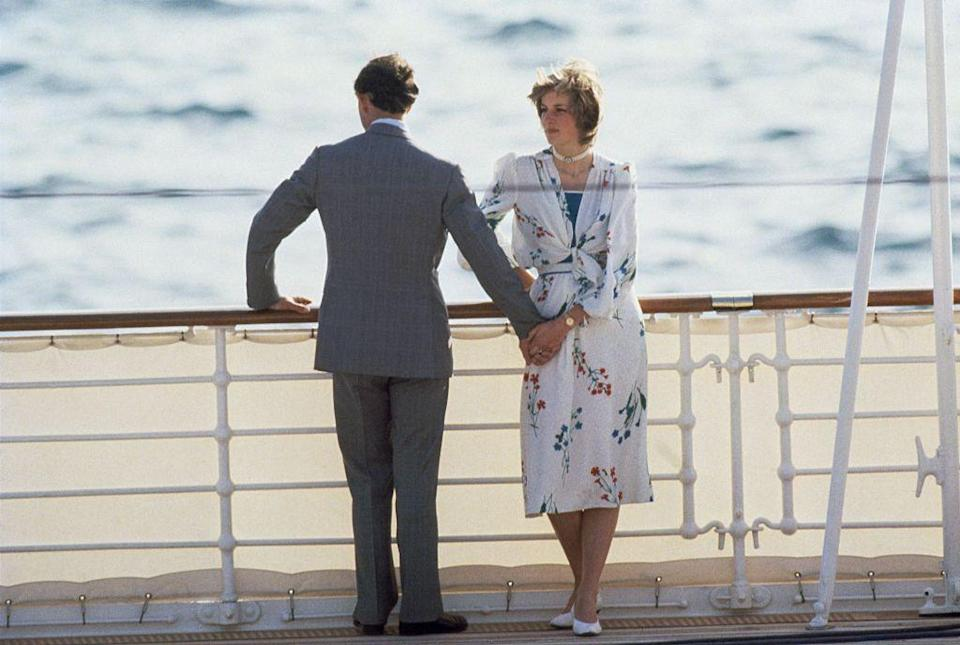 <p>Newlyweds Princess Diana and Prince Charles hold hands on the deck of the Royal Yacht Britannia on their honeymoon in 1981. The couple was leaving the port in Gibraltar to sail around the Mediterranean. </p>