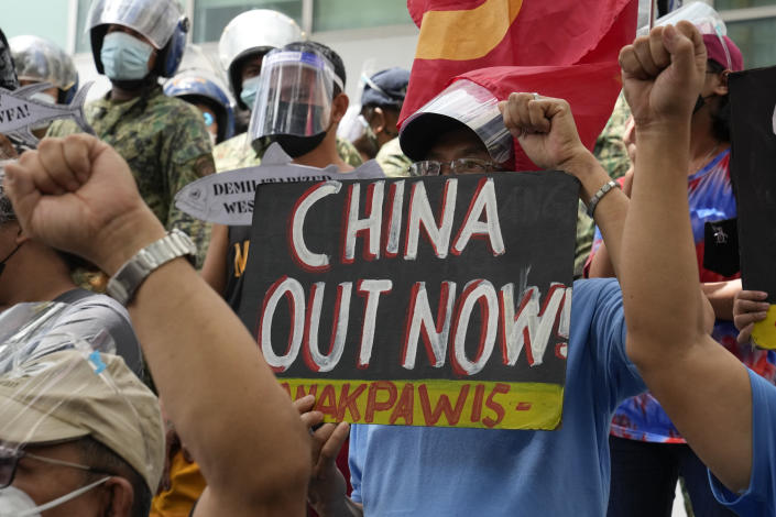 Protesters hold slogans during a rally in front of the Chinese Consulate in Makati city, Philippines on Monday, July 12, 2021. The demonstration was held to commemorate the 5th anniversary of the Arbitral Ruling in The Hague by the UNCLOS (United Nations Convention on the Law of the Sea) granting the Philippines the exclusive right to fish within its Exclusive Economic Zone or EEZ. (AP Photo/Aaron Favila)