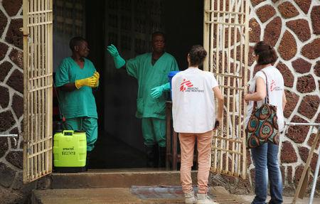 Medecins Sans Frontieres workers talk to a worker at an isolation facility prepared to receive suspected Ebola cases, at the Mbandaka General Hospital, in Mbandaka