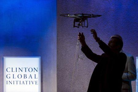 A man reaches out to catch a drone used to monitor rhinos in Africa to protect them from poaching during the Clinton Global Initiative's annual meeting in New York