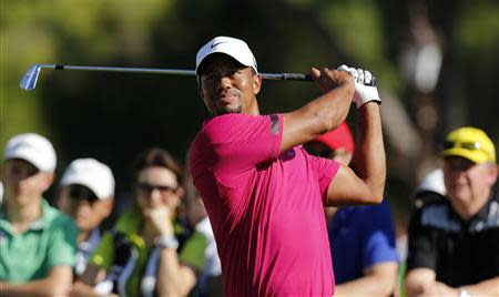 Tiger Woods of the U.S. tees off on the 10th hole during the third round of the inaugural Turkish Airlines Open in the southwest city of Antalya