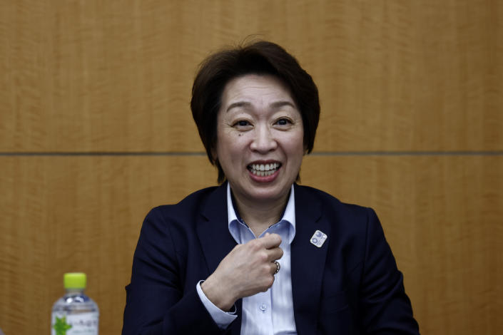 President of the Tokyo 2020 Olympics Organizing Committee Seiko Hashimoto smiles before the start of the opening remark session at a press briefing on the operation and media coverage of Tokyo 2020 Olympic Torch Relay in Tokyo Thursday, Feb. 25, 2021. (Behrouz Mehri/Pool Photo via AP)
