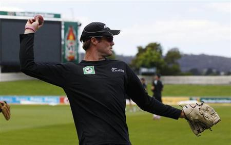 New Zealand's Martin Guptill bowls during a practice session ahead of the second test cricket match against Australia in Hobart December 8, 2011. REUTERS/Daniel Munoz