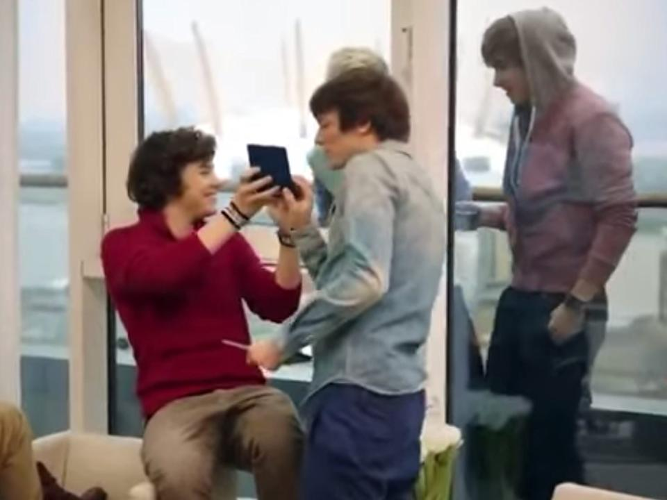 A still from One Direction's Pokémon ad.