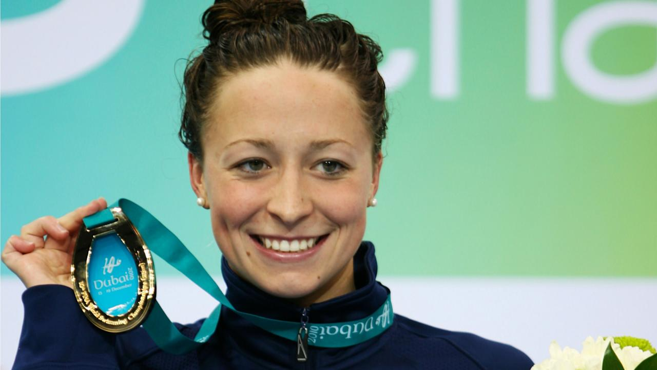 Ariana Kukors of the U.S. poses with her gold medal after the women's 100m individual medley finals at the 10th FINA World Swimming Championships (25m) in Dubai December 17, 2010.